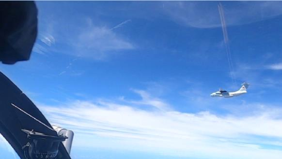 Transport Aircraft Over Disputed South China Sea Shoals